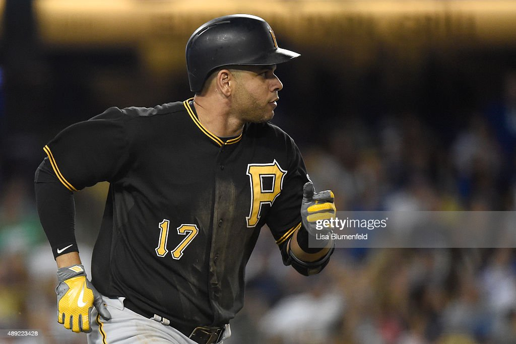 Aramis Ramirez of the Pittsburgh Pirates runs to first base after hitting a RBI single in the eighth inning against the Los Angeles Dodgers at Dodger...
