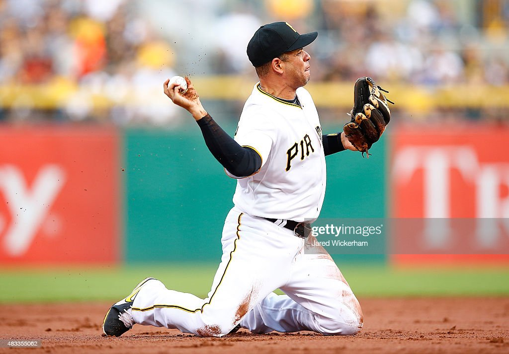 Aramis Ramirez #17 of the Pittsburgh Pirates throws to first base from his knees in the third inning against the Los Angeles Dodgers during the game at PNC Park on August 7, 2015 in Pittsburgh, Pennsylvania.
