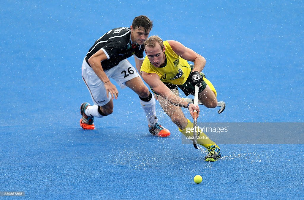 Aran Zalewski of Australia and Moritz Rothlander during the FIH Mens Hero Hockey Champions Trophy match between Germany and Australia at Queen...
