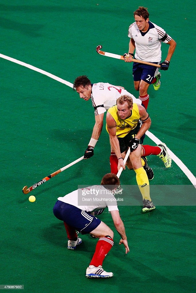 Aran Zalewski (yellow) of Australia battles for the ball with <a gi-track='captionPersonalityLinkClicked' href=/galleries/search?phrase=Henry+Weir&family=editorial&specificpeople=10009175 ng-click='$event.stopPropagation()'>Henry Weir</a> (bottom), Iain Lewers (C) and Tim Whiteman (top) of Great Britain during the Fintro Hockey World League Semi-Final match between Australia and Great Britain held at KHC Dragons Gemeentepark Stadium on July 3, 2015 in Brasschaat, Belgium.