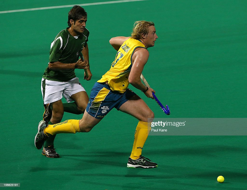 Aran Zalewski of Australia breaks clear of Muhammad Rizwan of Pakistan in the mens Australia v Pakistan game during day one of the 2012 International Super Series at Perth Hockey Stadium on November 22, 2012 in Perth, Australia.
