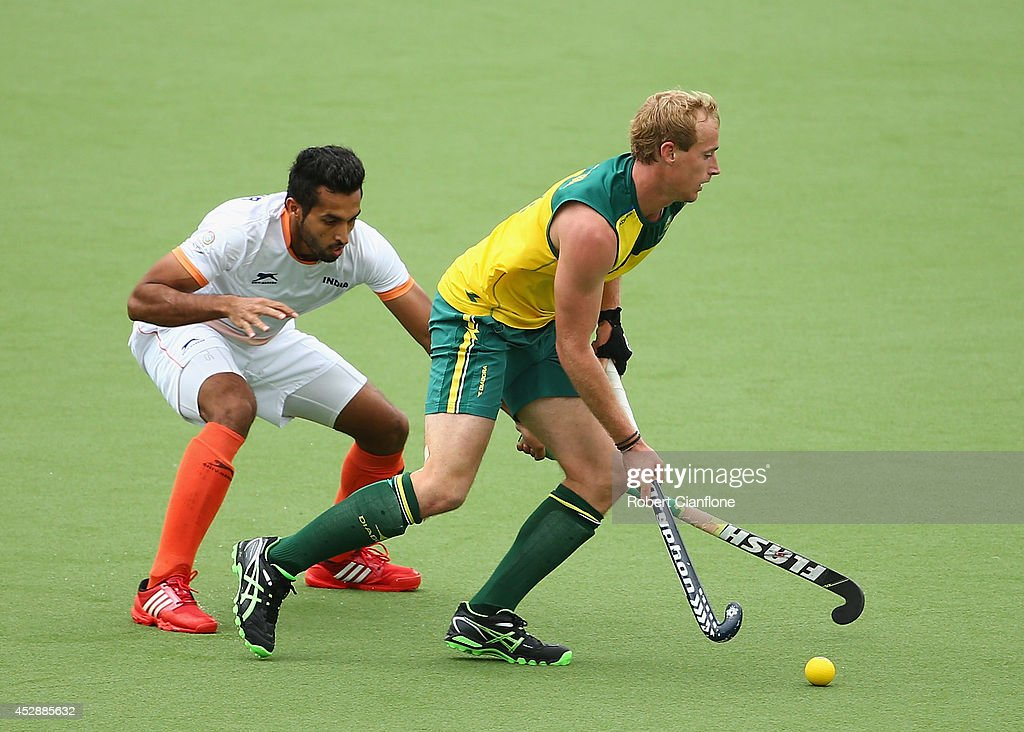 Aran Zalewski of Australia is challenged by <a gi-track='captionPersonalityLinkClicked' href=/galleries/search?phrase=Dharamvir+Singh+-+Field+Hockey+Player&family=editorial&specificpeople=16041870 ng-click='$event.stopPropagation()'>Dharamvir Singh</a> of India during the men's preliminaries match between India and Australia at the Glasgow National Hockey Centre during day six of the Glasgow 2014 Commonwealth Games on July 29, 2014 in Glasgow, United Kingdom.