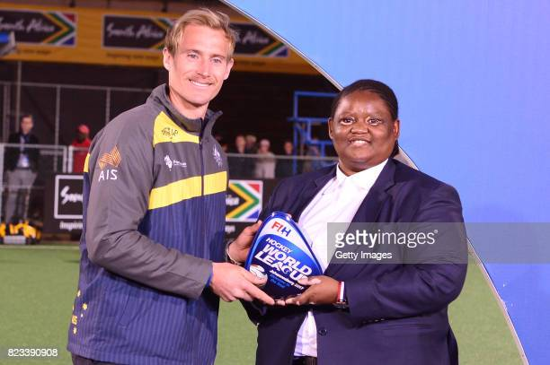 Aran Zalewski of Australia receives the trophy from Vice President of the South African Hockey Association Lwandile Simelane during day 9 of the FIH...