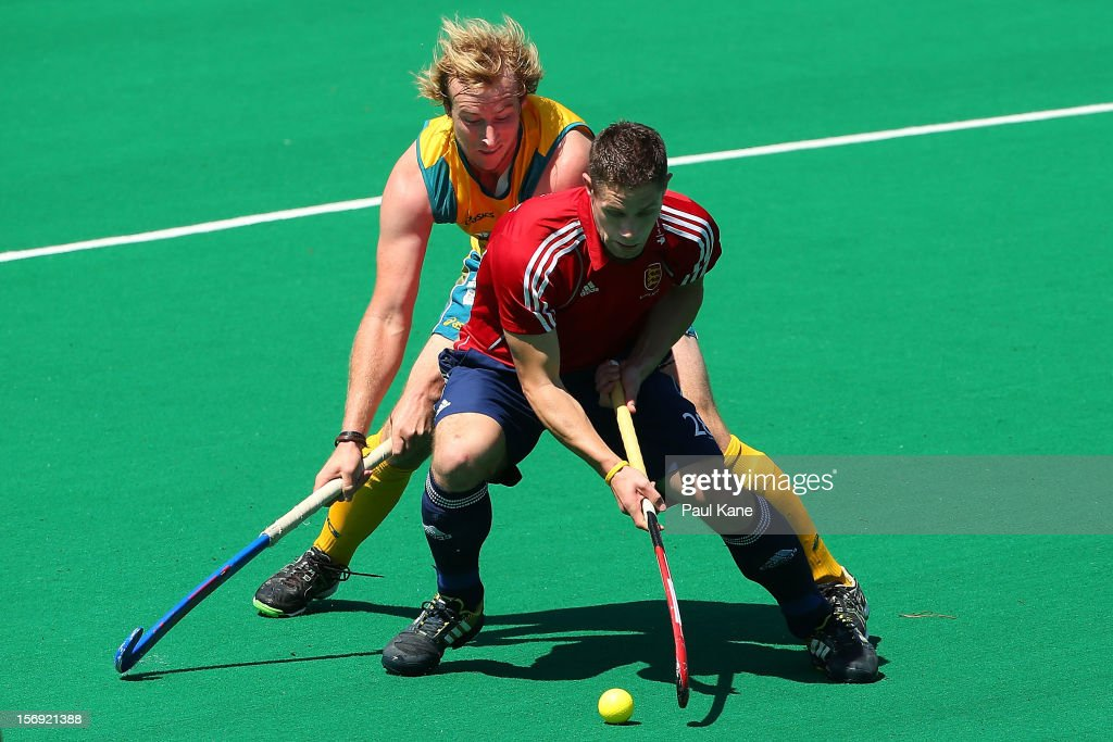 Aran Zalewski of the Kookaburras tackles Mark Gleghorne of England in the gold medal match between the Australian Kookaburras and England during day four of the 2012 International Super Series at Perth Hockey Stadium on November 25, 2012 in Perth, Australia.