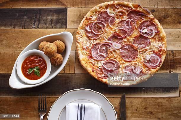 Arancini and la motta thin crust pizza are pictured at La Motta's Italian Specialties in Boston on Jan 20 2016