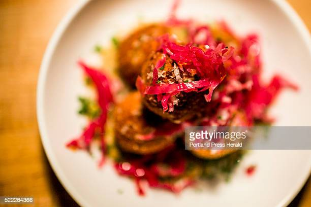 Arancini eggplant puree with picked cabbage and mozzarella photographed for Dine Out Maine at Roustabout Friday April 8 2016
