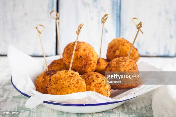 Arancini with skewers on a plate