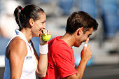 Arantxa Parra Santonja and Marc Lopez of Spain during their first round mixed doubles match against Sara Errani and Fabio Fognini of Italy during day...