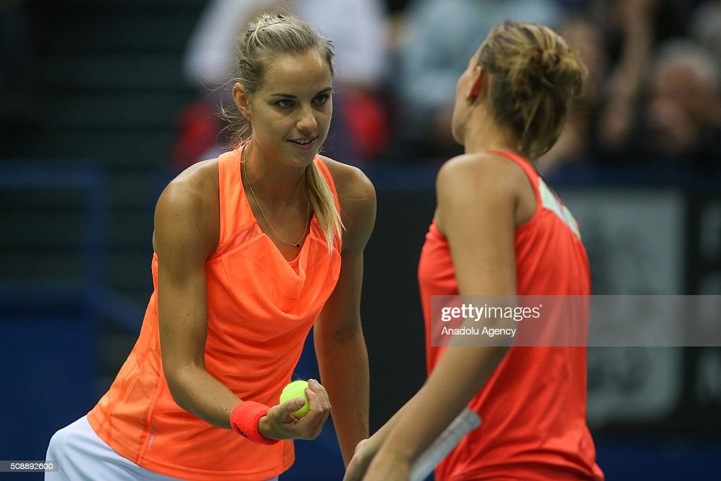 Arantxa Rus (L) and Cindy Burger (R) of Netherlands in an action against Ekaterina Makarova and Daria Kasatkina of Russia during the Fed Cup World Group First round tennis match in Moscow, Russia on February 7, 2016.