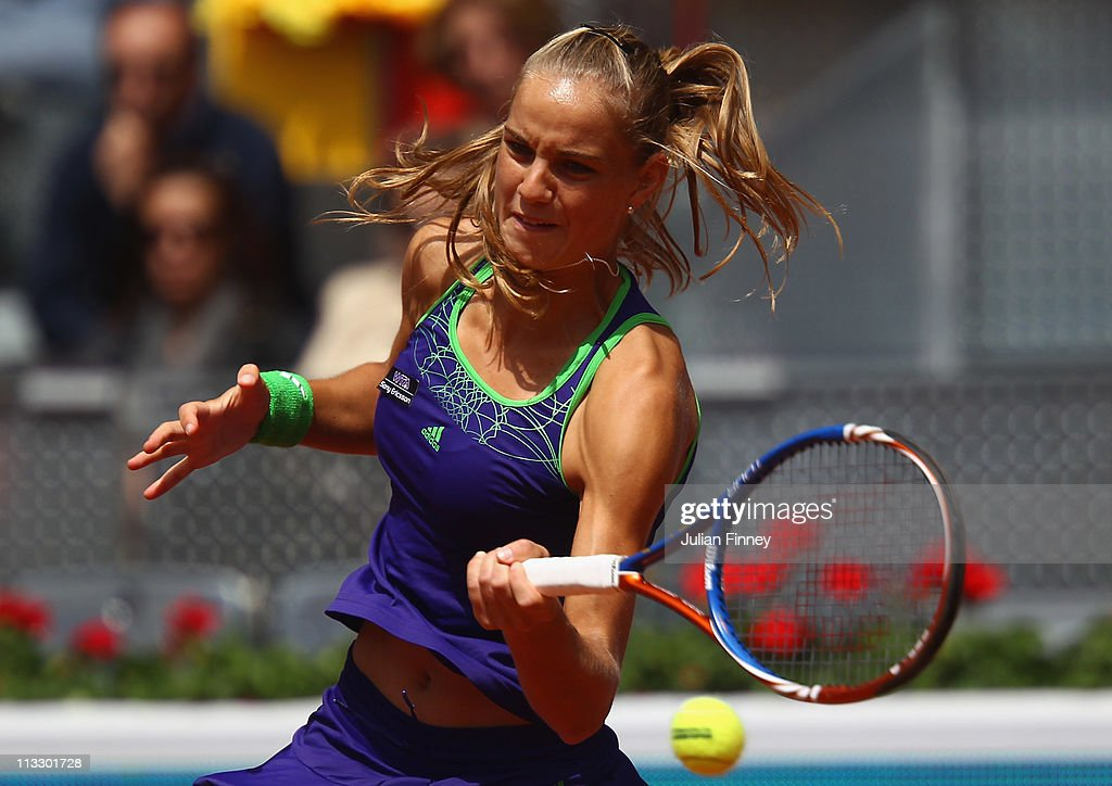 <a gi-track='captionPersonalityLinkClicked' href=/galleries/search?phrase=Arantxa+Rus&family=editorial&specificpeople=4387294 ng-click='$event.stopPropagation()'>Arantxa Rus</a> of Holland plays a forehand in her match against Maria Sharapova of Russia during day two of the Mutua Madrilena Madrid Open Tennis on May 1, 2011 in Madrid, Spain.