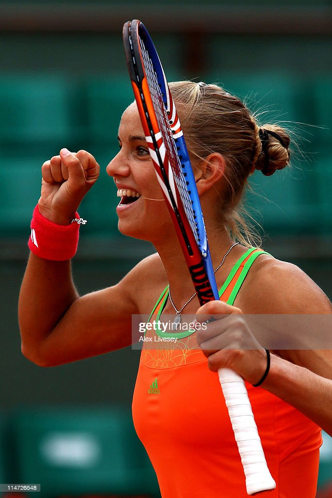 <a gi-track='captionPersonalityLinkClicked' href=/galleries/search?phrase=Arantxa+Rus&family=editorial&specificpeople=4387294 ng-click='$event.stopPropagation()'>Arantxa Rus</a> of Netherlands celebrates her victory during the women's singles round two match between <a gi-track='captionPersonalityLinkClicked' href=/galleries/search?phrase=Arantxa+Rus&family=editorial&specificpeople=4387294 ng-click='$event.stopPropagation()'>Arantxa Rus</a> of Netherlands and Kim Clijsters of Belgium on day five of the French Open at Roland Garros on May 26, 2011 in Paris, France.