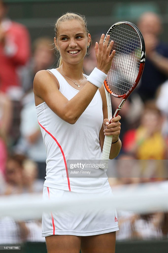 <a gi-track='captionPersonalityLinkClicked' href=/galleries/search?phrase=Arantxa+Rus&family=editorial&specificpeople=4387294 ng-click='$event.stopPropagation()'>Arantxa Rus</a> of Netherlands celebrates match point during her Ladies' singles second round match against Samantha Stosur of Australia on day three of the Wimbledon Lawn Tennis Championships at the All England Lawn Tennis and Croquet Club on June 27, 2012 in London, England.