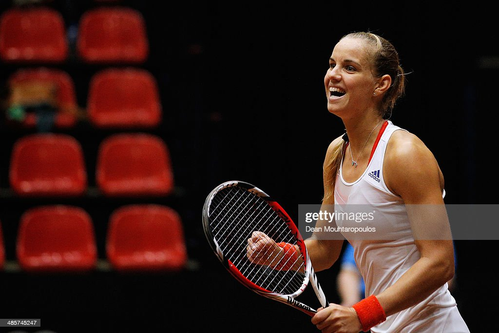 <a gi-track='captionPersonalityLinkClicked' href=/galleries/search?phrase=Arantxa+Rus&family=editorial&specificpeople=4387294 ng-click='$event.stopPropagation()'>Arantxa Rus</a> of Netherlands celebrates winning the match against Misaki Doi of Japan towards captain, Paul Haarhuis during the Fed Cup World Group II Play-off between Netherlands and Japan at the Maaspoort Sports end Events on April 20, 2014 in 's-Hertogenbosch, Netherlands.