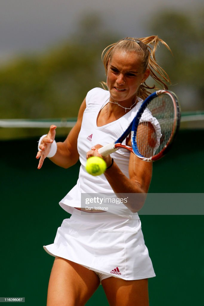 <a gi-track='captionPersonalityLinkClicked' href=/galleries/search?phrase=Arantxa+Rus&family=editorial&specificpeople=4387294 ng-click='$event.stopPropagation()'>Arantxa Rus</a> of Netherlands hits a forehand during her match against Lindsay Lee-Waters of USA on day three of the Wimbledon Championships 2011 Qualifying at the Bank of England Sports Ground on June 15, 2011 in London, England.