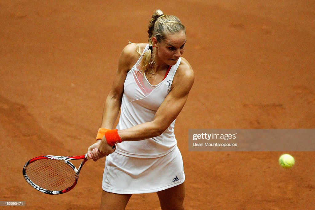 <a gi-track='captionPersonalityLinkClicked' href=/galleries/search?phrase=Arantxa+Rus&family=editorial&specificpeople=4387294 ng-click='$event.stopPropagation()'>Arantxa Rus</a> of Netherlands in action against Kurumi Nara of Japan during the Fed Cup World Group II Play-off match between Netherlands and Japan at the Maaspoort Sports end Events on April 19, 2014 in 's-Hertogenbosch, Netherlands.