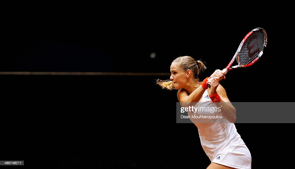 <a gi-track='captionPersonalityLinkClicked' href=/galleries/search?phrase=Arantxa+Rus&family=editorial&specificpeople=4387294 ng-click='$event.stopPropagation()'>Arantxa Rus</a> of Netherlands in action against Misaki Doi of Japan during the Fed Cup World Group II Play-off match between Netherlands and Japan at the Maaspoort Sports end Events on April 20, 2014 in 's-Hertogenbosch, Netherlands.