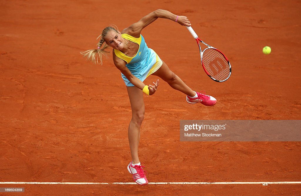 <a gi-track='captionPersonalityLinkClicked' href=/galleries/search?phrase=Arantxa+Rus&family=editorial&specificpeople=4387294 ng-click='$event.stopPropagation()'>Arantxa Rus</a> of Netherlands serves during her women's singles match against Sara Errani of Italy during day one of the French Open at Roland Garros on May 26, 2013 in Paris, France.
