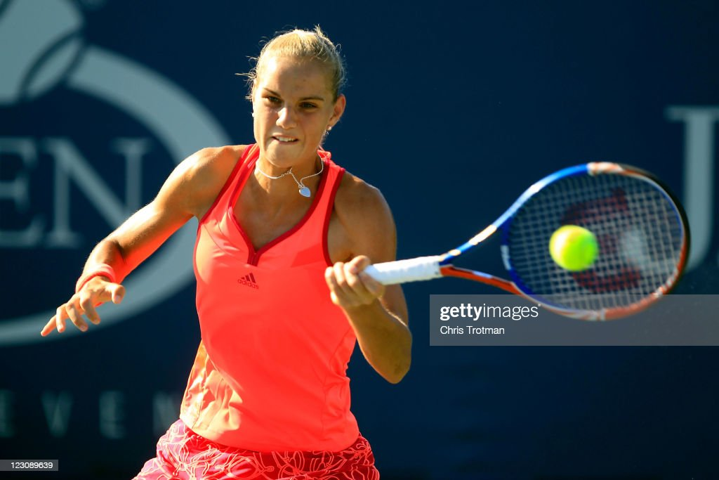 <a gi-track='captionPersonalityLinkClicked' href=/galleries/search?phrase=Arantxa+Rus&family=editorial&specificpeople=4387294 ng-click='$event.stopPropagation()'>Arantxa Rus</a> of the Netherlands returns a shot against Elena Vesnina of Russia during Day Two of the 2011 US Open at the USTA Billie Jean King National Tennis Center on August 30, 2011 in the Flushing neighborhood of the Queens borough of New York City.