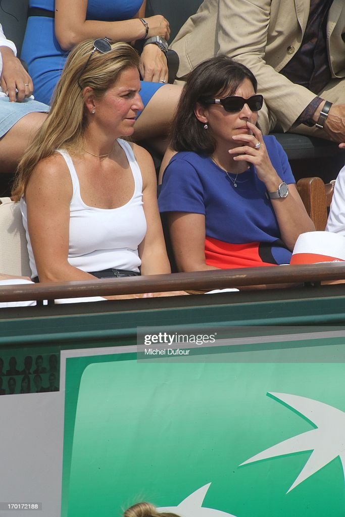 Arantxa Sanchez and <a gi-track='captionPersonalityLinkClicked' href=/galleries/search?phrase=Cecile+Duflot&family=editorial&specificpeople=4057002 ng-click='$event.stopPropagation()'>Cecile Duflot</a> seen as Celebrities At French Open 2013 - Day 14 at Roland Garros on June 8, 2013 in Paris, France.