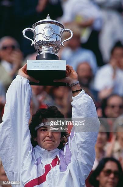 Arantxa Sanchez Vicario of Spain holds aloft the Suzanne Lenglen trophy after winning the Women's Singles Final match against Steffi Graf at the...