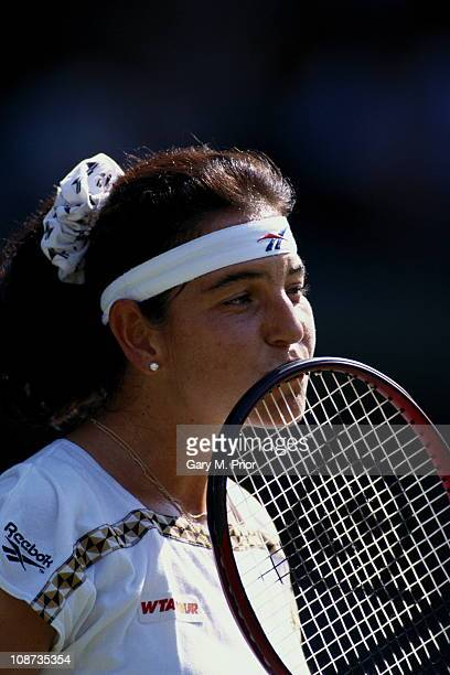 Arantxa Sanchez Vicario of Spain kisses her racquet during her Women's Singles match against Mana Endo at the Wimbledon Lawn Tennis Championship on...