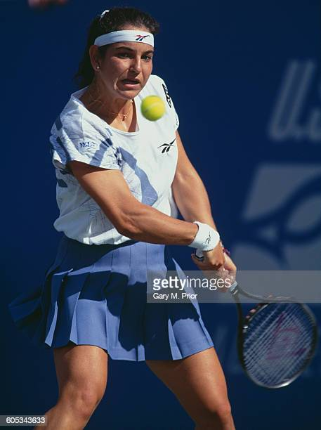 Arantxa Sanchez Vicario of Spain makes a double back hand return against Joannette Kruger during the Women's Singles second round match of the US...