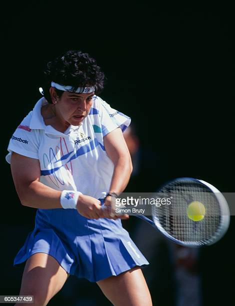 Arantxa Sanchez Vicario of Spain makes a double hand return during a Women's Singles first round match at the ATP Lipton International Players...
