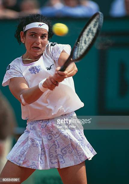 Arantxa Sanchez Vicario of Spain makes a double hand return during the Women's Singles Final match against Steffi Graf at the French Open Tennis...