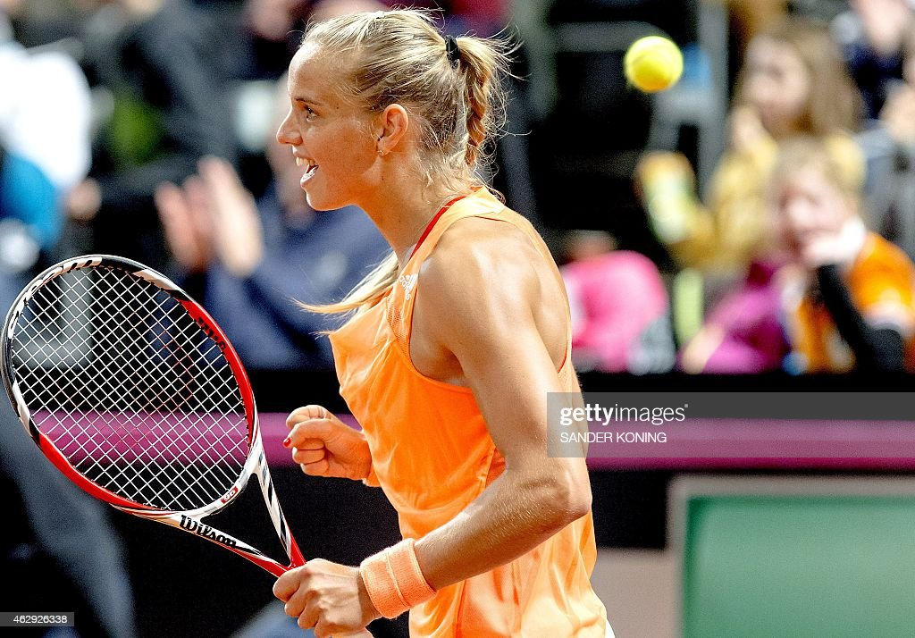Aranxta Rus from Netherlands reacts during her match against Magdalena Rybarikova of Slovakia during the International team competition in women's tennis Fed Cup in Apeldoorn on February 7, 2015. AFP PHOTO / ANP PHOTO / SANDER KONING netherlands out