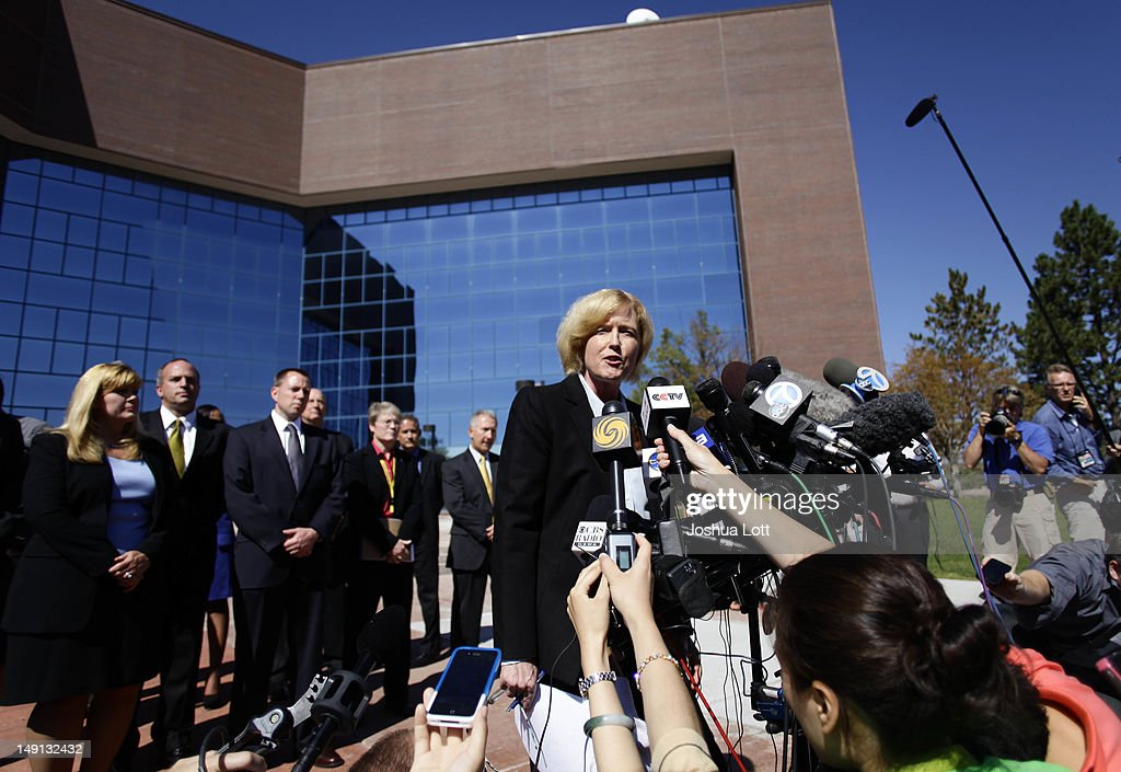 Arapahoe County District Attorney Carol Chambers talks to members of the news media before heading into the Arapahoe County Courthouse for suspect James Holmes' first court appearance July 23, 2012 in Centennial, Colorado. Chambers said the prosecutor's office would consult with family members when deciding whether or not to pursue the death penalty for James Holmes, 24, who is accused of killing 12 people and injuring 58 in a shooting spree July 20, during a screening of 'The Dark Knight Rises.' in Aurora, Colorado.