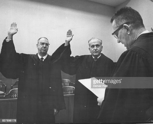 Arapahoe District Judges Take Oath Dist Judge William B Naugle right administer the oath of office to Dist Judges Robert B Lee left and Marvin W...