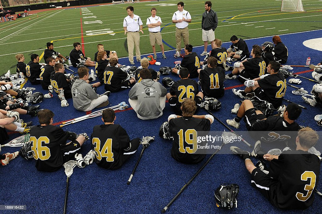 Arapahoe High School lacrosse player get a pep talk from coaches at halftime against Regis Jesuit during the semifinals of the CHSAA 5A boys lacrosse at All City Stadium on May 15, 2013, in Denver, Colorado. Arapahoe won 13-5 to advance to the finals.