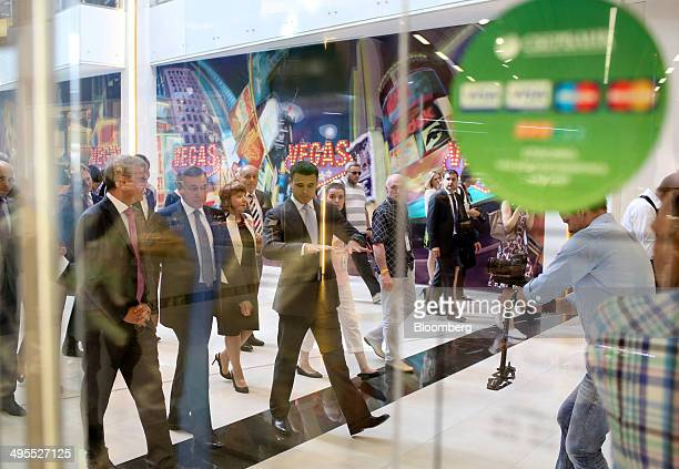 Aras Agalarov founder of Crocus Group center left Herman Gref chief executive officer of OAO Sberbank left and Emin Agalarov commercial director of...