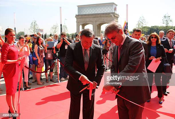 Aras Agalarov founder of Crocus Group left and Herman Gref chief executive officer of OAO Sberbank cut a red ribbon to mark the opening of the new...