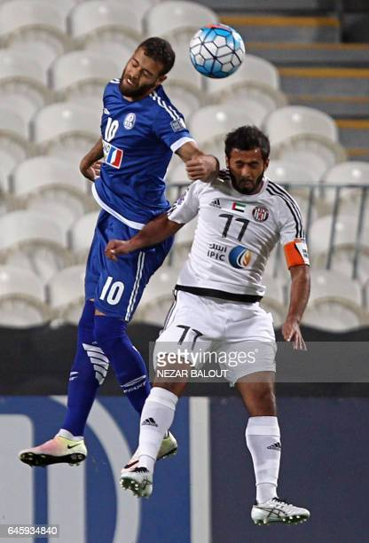 Arash Afshin from Iran's Esteghlal Khuzestan club fights for the ball against Sultan Barghash from UAE's alJazira's during an Asian Champions League...