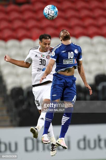 Arash Afshin from Iran's Esteghlal Khuzestan club fights for the ball against Joao Carlos Chaves from UAE's alJazira's during an Asian Champions...