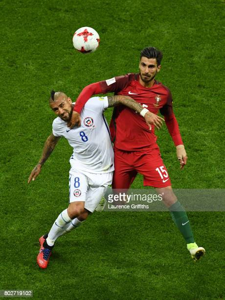 Araturo Vidal of Chile and Andre Gomes of Portugal battle for possession during the FIFA Confederations Cup Russia 2017 SemiFinal between Portugal...