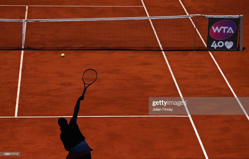 Aravane Rezai of France in action against Yulia Putintseva of Kazakhstan during the Mutua Madrid Open tennis tournament at the Caja Magica on May 4, 2013 in Madrid, Spain.