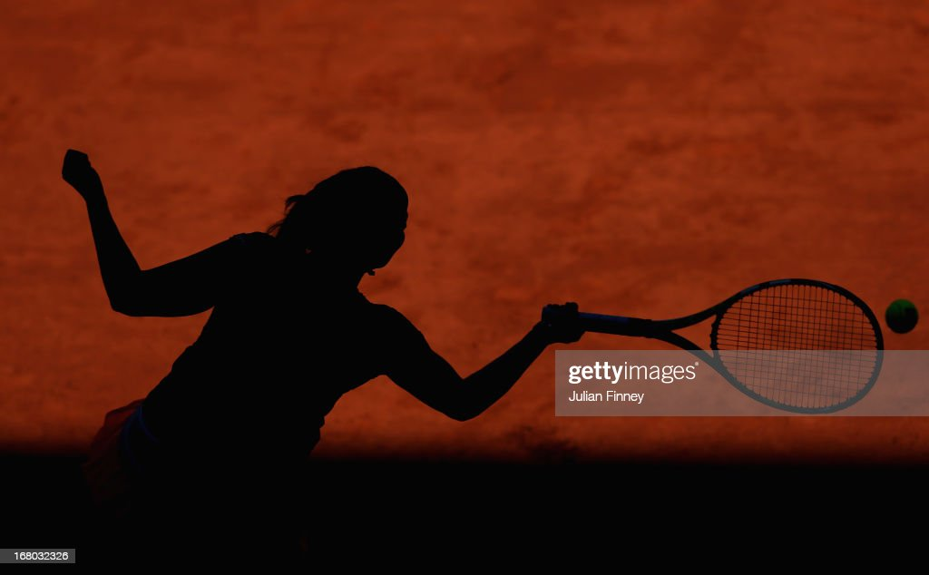 <a gi-track='captionPersonalityLinkClicked' href=/galleries/search?phrase=Aravane+Rezai&family=editorial&specificpeople=598150 ng-click='$event.stopPropagation()'>Aravane Rezai</a> of France in action against Yulia Putintseva of Kazakhstan during the Mutua Madrid Open tennis tournament at the Caja Magica on May 4, 2013 in Madrid, Spain.