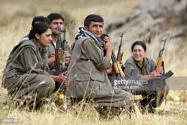 Guerrilla fighters of the PKK listen to instructions from their team commander during a training session in a camp near Arbil in the Haqourqi...