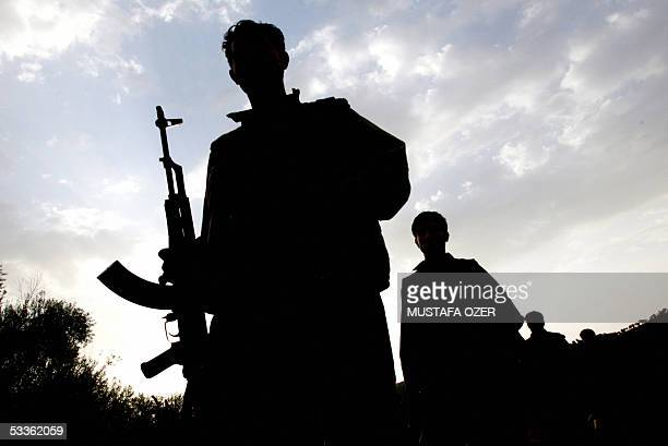 PKK members on their way to practice in a guerilla camp at Haqourki Mountain near Diana 11 August 2005 Prime Minister Recep Tayyip Erdogan pledged...