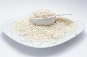 Arborio rice with quarter cup measuring spoon
