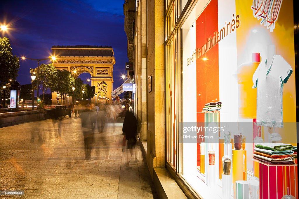 Arc de Triomphe and shops on Avenue des Champs-Elysees.