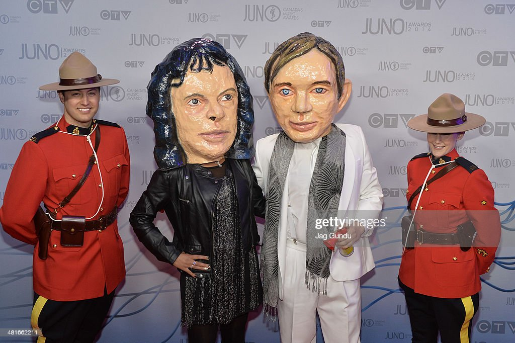 Arcade Fire Bobbleheads arrive on the red carpet at the 2014 Juno Awards on March 30, 2014 in Winnipeg, Canada.