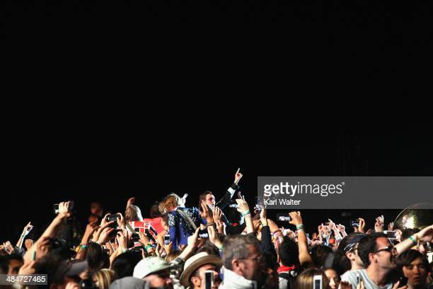 Arcade Fire performs onstage during day 3 of the 2014 Coachella Valley Music Arts Festival at the Empire Polo Club on April 13 2014 in Indio...