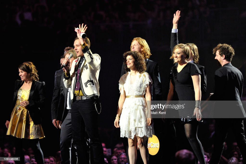 <a gi-track='captionPersonalityLinkClicked' href=/galleries/search?phrase=Arcade+Fire&family=editorial&specificpeople=2220929 ng-click='$event.stopPropagation()'>Arcade Fire</a> receive the International Album award on stage at The BRIT Awards 2011 at O2 Arena on February 15, 2011 in London, England.