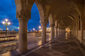 Arcade of the Doges Palace at night.