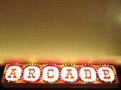 arcade sign hanging and glowing from the ceiling