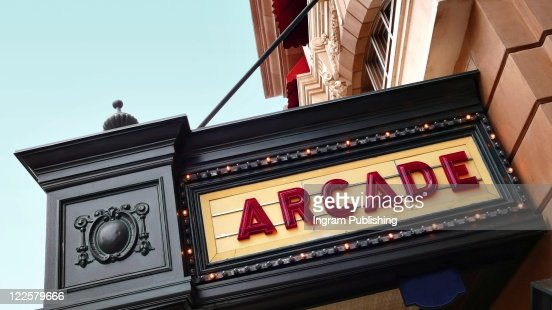Arcade sign on old movie theatre playbill. : Stock Photo