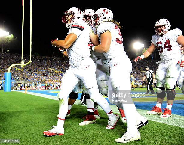 ArcegaWhiteside of the Stanford Cardinal celebrates his touchdown with Daniel Marx and AT Hall to take the lead over the UCLA Bruins 1513 during the...